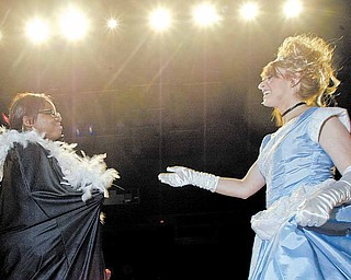 """Chaney High School students Janaiah Spearman, left, as the Fairy Godmother, and Kaitlyn Cook as Cinderella rehearse a scene from """"Cinderella"""" Wednesday at the school. Friday evening's performance will be the final traditional theatrical production at the school."""