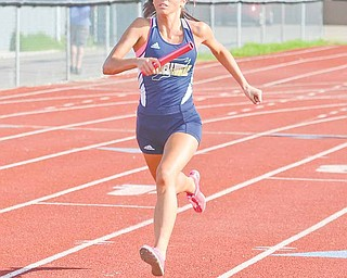 Ashley Moore carries the baton for Lowellville in the girls' 4x100-meter relay race during the ITCL Tier 2 track meet Wednesday. The Lowellville girls took home second place in the overall team competition.