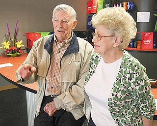 Roger and Gloria Jones, for whom the Oh Wow! children's center is named, talk Thursday morning about their contribution to and interest in the facility at 11 W. Federal St., Youngstown.