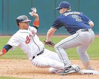 Cleveland Indians base runner Orlando Cabrera is picked off second by Tampa Bay Rays second baseman Elliot Johnson in the sixth inning of a baseball game in Cleveland on Thursday,  May 12, 2011.   (AP Photo/Amy Sancetta)