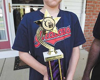 Austin Jones, 10, holds up the trophy his father, Jerry Jones, received for walking all 24 hours of the 2010 Relay For Life of Boardman. Last year, Jerry, then 46, set the record for the oldest person to complete the entire event in Boardman.