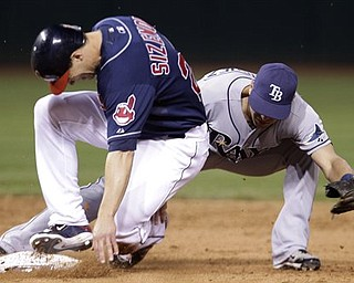 Cleveland Indians center fielder Grady Sizemore, left,  slides safely into second base in the sixth inning in a baseball game against the Tampa Bay Rays, Tuesday, May 10, 2011, in Cleveland.  Sizemore jammed his right knee, not the one he had season-ending microfracture surgery on in 2010, while sliding into second base in the sixth inning of Tuesday night's 5-4 victory over Tampa Bay, the Indians' 14th straight win at home. After being checked, he stayed in the game. However, the three-time All-Star had knee soreness on Wednesday, so the Indians' medical staff decided to have him undergo an MRI.