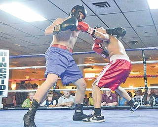 Demitryus Martinez of Struthers (in red) lands a punch to the face of Nick Lardas of Niles (blue) during their bout in the cruiserweight division of the K.O. Drugs Boxing Tournament on Friday at the ITAM Banquet Center in Youngstown. Martinez won the match.