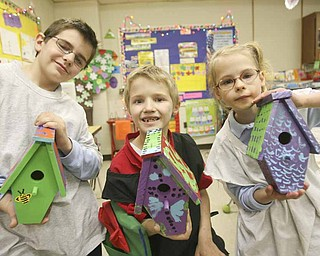 Mollie Kessler School students, from left, Paul Walker, Alex Ferguson and Natalie Rhinehart show off their finished birdhouses that they painted for Habitat for Humanity. The students studied homelessness in school.