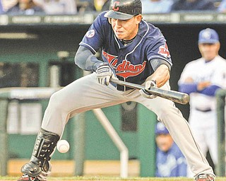Cleveland Indians' Asdrubal Cabrera bunts during the first inning of a baseball game against the Kansas City Royals in Kansas City, Mo., Tuesday, May 17, 2011. The bunt advanced teammate Michael Brantley to third base.