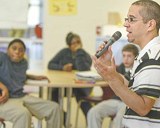 """Author Jaime Adoff visits with students at Wilson Middle School in Youngstown on Tuesday as part of Right to Read Week. Sixth-grade students are reading Adoff's book, """"Jimi and Me,"""" recipient of the 2006 Coretta Scott King/John Steptoe New Talent Author Award."""