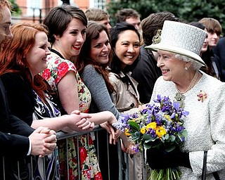 Britain's Queen Elizabeth II meets students and staff at Trinity College Dublin, Tuesday May 17, 2011. The Queen set foot on Irish soil at the start of a historic state visit which will herald a new era in relations between Britain and the Republic. Politicians on both side of the Irish Sea have described the four-day event as momentous.