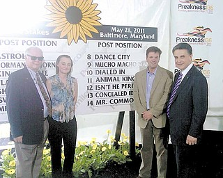 Canfield's Bruce Zoldan, far right, stands with, from left, Barry Irwin, Kathy Irwin and Animal Kingdom trainer Graham Motion after Wednesday's post drawing for Saturday's Preakness Stakes at Pimlico Race Course in Baltimore. Irwin owns Team Valor which owns the Kentucky Derby winner. Zoldan is one of the Team Valor investors.