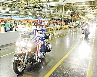 """William D. Lewis The Vindicator Gary """"Bones"""" Mowen, a GM Lordstown retiree, leads a group of more thn 30 motorcycles through the GM plant early Thursday morning during the 15 th annual GM Lordstown Bike Show. The event raised money for the March Of Dimes Charity. Mowen, an avid rider is known for wearing an Uncle Sam costume while riding his motorcycle."""