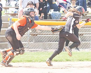 SOFTBALL - (1) Ali Prologo of Canfield tries to get away from catcher Emily Price during thier game Thursday afternoon in Boardman.