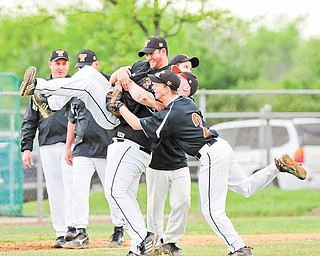 Springfield head baseball coach Matt Weymer is picked up during the celbratin by his players Aaron Yoder and Mike Semach.