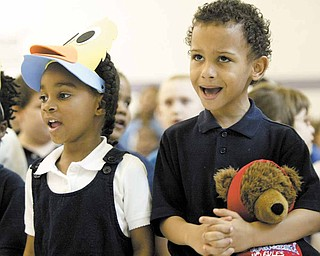 Williamson Elementary School kindergarten students Dream Jones and Elijah Lamar sing during a program Monday at the school. The ceremony, which celebrated mothers, was sponsored by the English as a Second Language program.