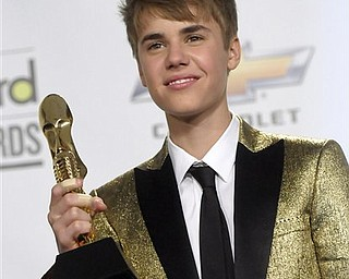 Singer Justin Bieber poses in the press room at the 2011 Billboard Music Awards in Las Vegas on Sunday, May 22, 2011.