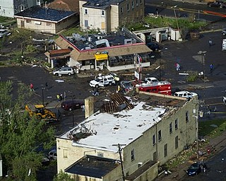 This aerial view shows tornado damage in Minneapolis, Sunday, May 22, 2011. At least one person died when the tornado barreled through the residential portion of Minneapolis on Sunday, damaging at least 100 homes, toppling hundreds of trees and injuring at least 29 people.