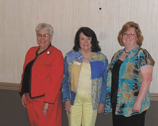 Winners of Best in Show awards during a Spring Extravaganza sponsored by the Niles Chapter of the American Sewing Guild are, from left, Gretchen Saunders, quilting; Patti Augustine, garment sewing; and Denise Cline for an afghan in the miscellaneous category.