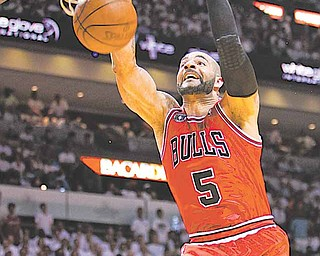 Chicago Bulls' Carlos Boozer dunks the ball during the first half of Game 4 of the NBA Eastern Conference finals basketball series against the Miami Heat in Miami, Tuesday, May 24, 2011.