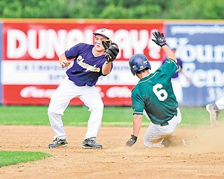 Anthony Rohan (6) of Ursuline slides safely into second base on a steal, beating the tag of Champion's second basemen, Tyler Chinchic.