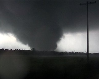 This frame grab from video shows a massive tornado on Sunday, May 22, 2011, outside Joplin, Mo.  The tornado tore a 6-mile path across southwestern Missouri killing at least 89 people as it slammed into the city of Joplin, ripping into a hospital, crushing cars like soda cans and leaving a forest of splintered tree trunks behind where entire neighborhoods once stood.
