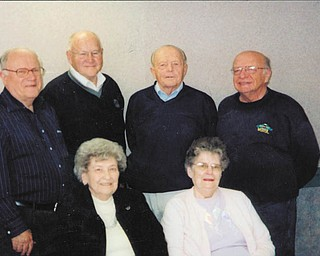 Making plans for the South High School Alumni Reunion on June 17 are, seated from left to right, Elberta Bullman Scott (Class of 1939), and Delores Rauschenberg Brindle (Class of 1946); and, standing, Chuck Whitman (Class of 1946), Dick Bennett (Class of 1951), Sonny Friend (Class of 1949), and John Athanasen (Class of 1959).