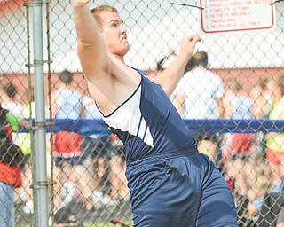 Austintown Fitch sophomore Billy Price throws during the discus finals at the Division I regional championship meet at Falcon Stadium. Price advanced to the state meet with a second-place finish.