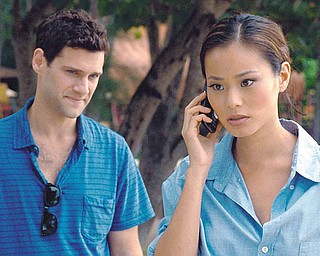 Justin Bartha as Doug and Jamie Chung as Lauren in Warner Bros. Pictures and Legendary Pictures comedy THE HANGOVER PART II, a Warner Bros. Pictures release.