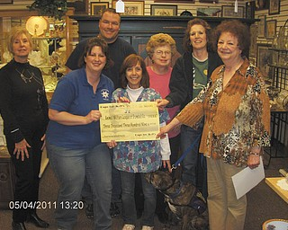 For the love of dogs: Cops for K9s presented a check May 4 for more than $3300 to the Animal Welfare League of Trumbull County. The money was raised at an annual garage sale. Pictured are volunteer Shirley Walters of Creative Talents 4-H Club, organizers Melissa and Chris Herlinger, shelter Director Debbie Agostinelli, volunteer Shirley Hryonak, volunteer Joy Knapp, and shelter President Barb Busko. Donations for next year's sale are being collected. Contact Cops for K9s at 330-883-1259 or email Copsfork9s@aol.com for more information.