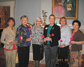 A tour of duty: Warren-Trumbull County American Association of University Women had its May meeting at the historic Harriet Taylor Upton House in Warren. After a tour of the house, officers for the coming season were installed. Receiving carnations as they accepted the responsibility of various offices were, from left, Mary Ognibene, secretary; Katylu Herriman, co-vice president for programs; Roz Jackson, member-at-large; Isabel Seavey, president; Bobbi Buehrle, member-at-large; and Diana Bauman, co-vice president for programs. Anyone interested in becoming a member of the organization should call 330-898-3696.