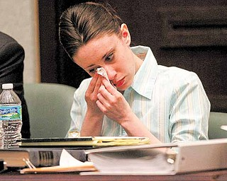 Casey Anthony reacts during her trial at the Orange County Courthouse, Thursday, May 26, 2011, in Orlando, Fla. Anthony is charged with murder in the 2008 death of her daughter Caylee. (AP Photo/Red Huber, Pool)