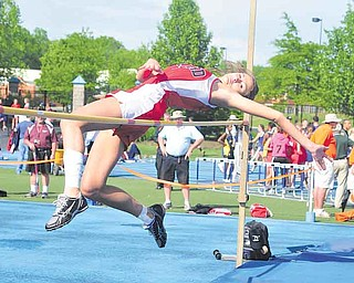 Girard's Ashley Wagner clears the bar during the high jump during the regional track meet at Ravenna High School.