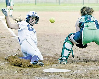 Poland's Kalie Benson slides into home to score as West Branch catcher Cheyenne Miller waits for the throw.