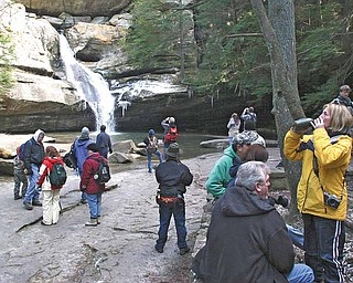 Hikers take a break at Cedar Falls, in Hocking Hills State Park, near Logan, Ohio.