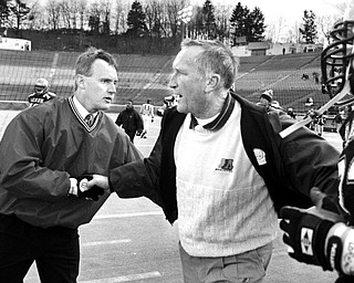 Jim Tressel shakes hands with Akron head coach Gerry Faust after Youngstown State defeated the Zips at the Rubber Bowl in 1993.