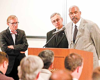 FILE- In this March 8, 2011 file photo, Ohio State athletic director Gene Smith, right, takes questions during a news conference with university president E. Gordon Gee, left, and football coach Jim Tressel, center, in Columbus, Ohio. Smith, unable to talk about the ongoing NCAA investigation, does touch upon some fine points of the suspensions of football coach Jim Tressel and five of his players. (AP Photo/Terry Gilliam, File)