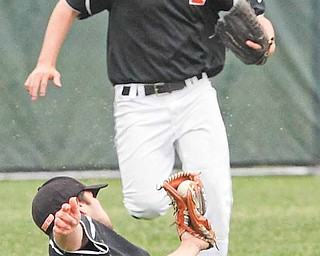 Springfield's Josh Horn watches as shortstop Cody Pitzo comes up with a diving catch during the Division IV baseball final against Columbiana. The Tigers are a game away from from a state fi nal berth.