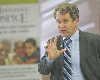 U.S. Sen. Sherrod Brown, D-Ohio, makes a point during a press conference as he discusses the Republican attempt to privatize Social Security and Medicare with senior citizens. He spoke Wednesday at the Senior Independence Senior Center on Fifth Avenue in Youngstown.