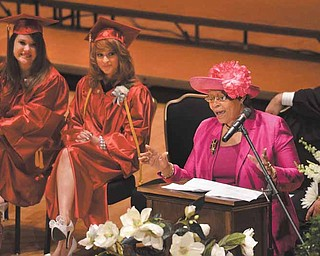 Keynote speaker Sarah Brown-Clark, Youngstown municipal clerk of courts, told the 2011 Chaney High School graduates not to depend on anyone else for their happiness. Seated next to her are salutatorian Jennifer Caventer, left, and valedictorian Kaitlyn Cook.