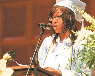 Keyona Woods, East High School Class of 2011 president and salutatorian, speaks at Thursday's commencement at Stambaugh Auditorium.
