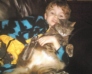 Richard Blair of Boardman sent this picture of his son, Rick, with their cat, Nora. Nora is 9, and the family adopted her in 2002.