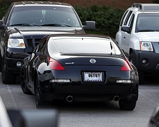 Ohio State quarterback Terrelle Pryor arrives in this Nissan 350Z, center, to a players only meeting Monday, May 30, 2011, at the Woody Hayes Complex, in Columbus, Ohio. (AP Photo/Terry Gilliam)