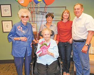 On hand to help Anna Kozmensky, center, celebrate her 103rd birthday on May 9 at Shepherd of the Valley-Niles were, from left, her sister, Fran Valcinic; her nieces, Kathy Bohach and Paula Terlecky; and her nephew, Jeff Terlecky.