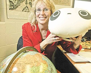 William d LEwis  the vindicator  Girard Jr HS Principal Louise Mason shows a stuffed panda toy presented to her while see was in China recently. She visited schools in China.