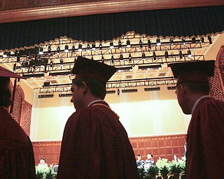 ROBERT  K.  YOSAY  | THE VINDICATOR --..Graduates on their way for diplomas - Cardinal Mooney's 53 Annual Commencement  at Stambaugh Auditorium . -30-..(AP Photo/The Vindicator, Robert K. Yosay)