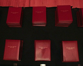 ROBERT  K.  YOSAY  | THE VINDICATOR --..Diplomas are ready as Cardinal Mooney's 53 Annual Commencement  at Stambaugh Auditorium . -30-..(AP Photo/The Vindicator, Robert K. Yosay)