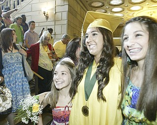 William d Lewis the Vindicator  Ursuline graduate Paige Larney is flanked by her sisters Jade, 13, left and Brooke, 15, after the Satyrday ceremony at Stambaugh Auditorium.