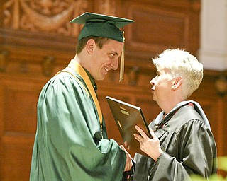 William d LEwis the Vindicator   Ursuline Valedictorian Matthew Metzinger is cdongratulated by principal Patricia Fleming during Saturday commencement at Stambaugh Auditorium