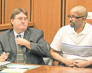 Anthony Sowell, left, the man charged with killing 11 women and dumping their remains around his property and home, appears in Common Pleas Court with his attorney John Parker as jury selection proceeds in his trial in Cleveland on Monday, June 6, 2011. (AP Photo/Marvin Fong, Pool)