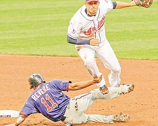 Cleveland Indians shortstop Asdrubal Cabrera, top, looks toward first base after forcing Ben Revere out at second base in the fifth inning in a baseball game, Monday, June 6, 2011, in Cleveland. Alexi Casilla was out at first base for the double play. (AP Photo/Tony Dejak)