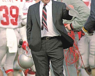 Ohio State Coach Earle Bruce patrols the sidelines during a game with Michigan in Ann Arbor, Mich., Nov. 21, 1987. Bruce was fired this week as head coach of the Buckeyes. (AP Photo/Robert Kozloff)