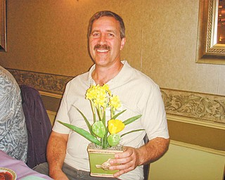 The gift of gardening: Phil Steiner, a radio talk-show host, gives gardening tips at a recent meeting of Trumbull Retired Teachers Association. The next meeting of the association will be at noon June 14 at Ciminero's Banquet Centre, 123 N. Main St., Niles. Ten students from nine Trumbull County public schools will be introduced as the 2011 TRTA scholarship recipients. The scholarship committee was Joyce Faiver, Una Ford and Ruby Hawkins. Anyone interested in attending the meeting should make reservations by Sunday by sending $11 to Mary Novotny, 5799 Sarah Ave. NW, Warren, OH 44483. Checks are to be made payable to TRTA. The group is still accepting early registration for the TRTA Spelling Bee at the Trumbull County Fair. For bee registration call 330-530-4011.