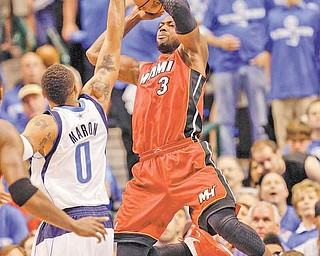 Miami Heat's Dwyane Wade (3) shoots over Dallas Mavericks' Shawn Marion (0) during the first half of Game 4 of the NBA Finals basketball game Tuesday, June 7, 2011, in Dallas. (AP Photo/David J. Phillip)